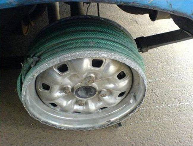 HorribleCarRepair-HoseTireTread.jpeg